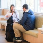 12/15/2016 - Grafton, Mass. - Melissa Precopio, V17, talks with a client in the lobby of the Foster Hospital for Small Animals on December 15, 2016. The Cummings School of Veterinary Medicine recently completed an expansion and renovation of the lobby, examination rooms and areas of the ER at the on-campus hospital. (Alonso Nichols/Tufts University)